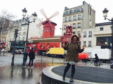 Posing outside Moulin Rouge