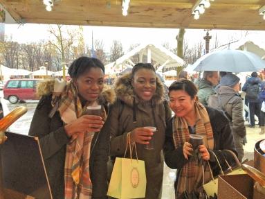 Sampling hot wine at the Christmas Stalls