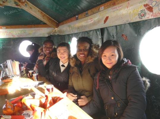 Drinking hot wine with friends in a tippee tent, Klein Scheidegg Switzerland